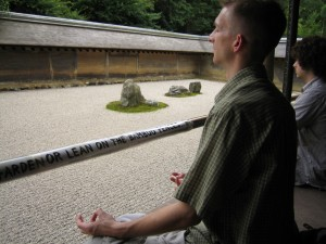 Brandon meditating at the zen garden