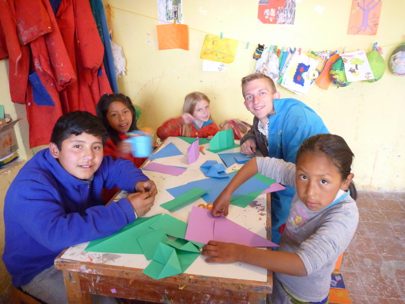 Making origami with Yanapay kids