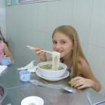 Emily eating Pho