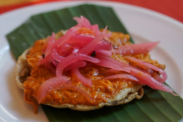 "This was probably our favorite dish on the food tour. ""Panuchos de Conchinita Pibil"", which is a crispy corn tortilla topped with shredded slow roasted suckling pig marinated in a strong citris juice topped with red pickled onions). At La Casa del Diezmo restaurant in San Miguel"