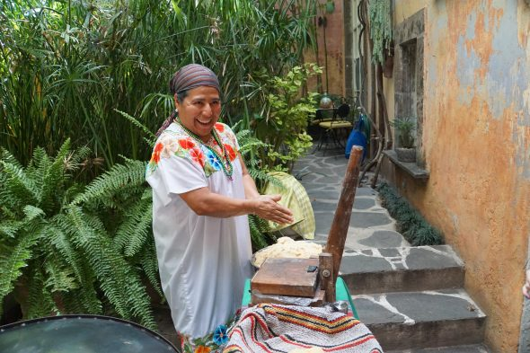 Mexican woman making fresh tortillas